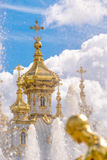 Fountain and church of the palace of Peterhof. St Petersburg, Russia Royalty Free Stock Photos