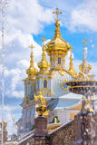 Fountain and church of the palace of Peterhof. St Petersburg, Russia Royalty Free Stock Photo