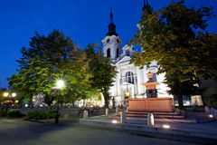 Fountain and church in Sremski Karlovci at night Stock Photo