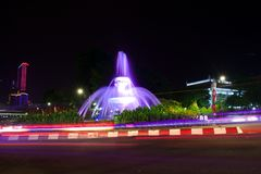 He fountain at the city intersection with the building`s background towering high behind Stock Image