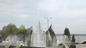 Fountain in the city of Nizhny Tagil, in the background busy road,time lapse. City pond sunset time.Along the coast road with heavy traffic. Near the road an stock video footage