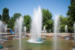 Fountain is in a city park. Blurred Motion Stock Images