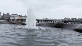 Fountain with city views. On a rainy and windy day fountain overlooking the Stockholm stock footage