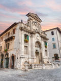 Fountain and clock tower in Spoleto, Italy Stock Image