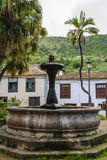 Fountain. Close-up picture - spanish sqare with houses in the back Stock Photo