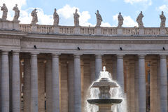 Fountain and colonnade on piazza San Pietro Stock Images