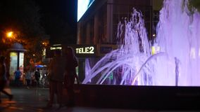 A fountain with colored water lighting, in the evening. close-up, blur, 4k stock video footage