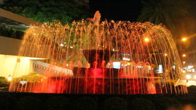 Fountain. Colored water fountain at night stock footage