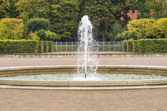 Fountain with colorful autumn trees on background Royalty Free Stock Image
