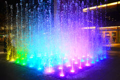 Fountain with colorful illuminations Royalty Free Stock Photos
