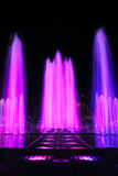 Fountain with colorful illuminations at night Royalty Free Stock Images