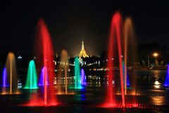 Fountain with colorful illuminations at night near the Shwedagon Royalty Free Stock Photography