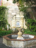 Fountain in Courtyard. Charming Fountain in Courtyard Stock Photography