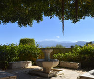 Fountain in the courtyard. On a background of mountains Stock Images