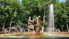 Fountain creating a colorful rainbow stock footage