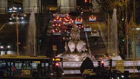 Fountain of Cybele and transport traffic on Alcala street in night Madrid, Spain stock video