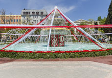 Fountain decorated with flowers and ribbons on the flower festiv Royalty Free Stock Photos
