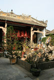 A fountain decorated with a sculptured dragon was installed in the courtyard of a temple in Hoi An (Vietnam) Royalty Free Stock Images