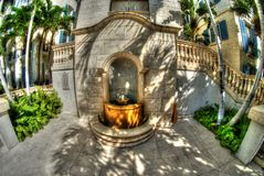 Decorative fountain at the Regent Grand hotel on Providenciales, TCI. Decorative drinking fountain in neocolonial style at the Regent Grand hotel on Royalty Free Stock Photos