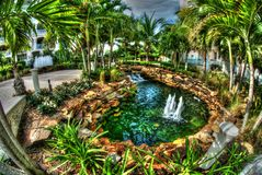 Fountain at Seven Stars resort, on Providenciales. Decorative fountain surrounded by palms at tropical resort Stock Image