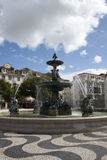 Fountain on Dom Pedro IV square in Lisbon Royalty Free Stock Photos