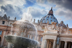 The fountain and the dome of St. Peter's Basilica in Vatican City. stock photo