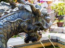 Fountain dragon statue. Chinese fountain dragon head statue stock image