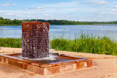Fountain with drinking water at the lake in sunny day Royalty Free Stock Images