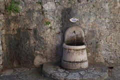 A fountain with drinking water in the village Royalty Free Stock Photos