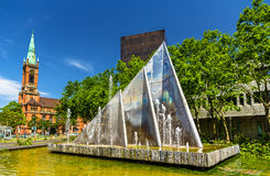 Fountain in Dusseldorf, Germany. A fountain and the Johannes Church in Dusseldorf, Germany Royalty Free Stock Photography