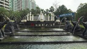 Fountain at the entrance to the respectable urban residential complex Time Coast in Sanya City stock footage video stock video
