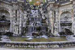 Fountain with faunus statues and streaming water at Zwinger pala Stock Photos
