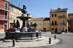 Offida medieval town in central Italy. Fountain of the Flora Goddess in the historic center of the medieval town of Offida in the Province of Ascoli Piceno royalty free stock photography