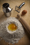 Fountain of flour for pasta and desserts. Fountain of flour with egg on a pastry Royalty Free Stock Photos