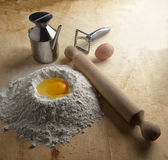 Fountain of flour for pasta and desserts. Fountain of flour with egg on a pastry Stock Image