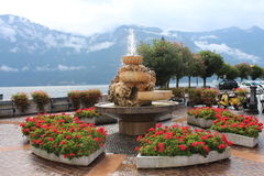 Fountain between flowering geraniums, on the shores of Lake Garda. Italy, Europe Royalty Free Stock Images