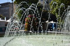 Fountain flowers inspired by the summer. Drops of water flowing in the air among flower background, placed in front of the National Theater Ivan Vazov, downtown royalty free stock photo