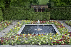 Fountain and flowers. Spring alley with beds of flowers and a fountain in Longwood Gardens PA NJ stock photography