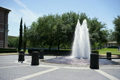 Fountain of flowing ideas. This towering fountain mirrors the learning atmosphere in front of the Jones Graduate School of Business at Rice University, Houston Royalty Free Stock Images
