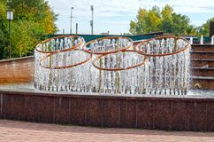 Fountain in the form of Olympic symbols, 5 intertwined Olympic rings royalty free stock photos