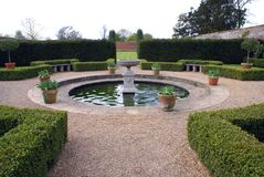 Fountain in a formal garden Stock Images