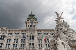 The Fountain of the Four Continents and the Town Hall, Piazza Unità d`Italia, Trieste, Friuli Venezia Giulia, Italy royalty free stock image