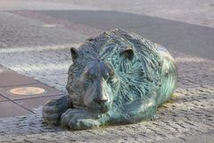 Fountain of the Four Quarters, bronze sculpture of a lion , Gdansk, Poland. Fountain of the Four Quarters, bronze sculpture of a lion lying on the street royalty free stock photos