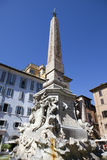 Fountain of the Four Rivers (Fontana dei Quattro Fiumi) with an Egyptian obelisk. Italy. Rome. Navon Square (Piazza Navona). Stock Photography