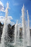 Fountain Four seasons in the Alexander garden and Manezh square. Beautiful and powerful jet fountain the Four seasons in the Alexander garden and Manezh square Stock Photos