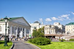 "Fountain ""the Four Seasons"" in Alexandrovsky garden. The Manezh Central Exhibition Hall and the old building of the Moscow stock image"