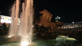 Fountain with the Four Seasons(4 bronze horses) sculptural group in Alexander Gardens  inMoscow,Russia (night). Fountain with the Four Seasons(4 stock video footage