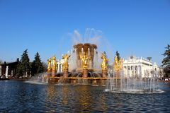 Fountain Friendship of Peoples (Moscow, VVC). Water fountains tourists people sculpture architecture decorative ornament park Moscow spray splash splashing stock photography
