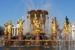 Fountain Friendship of Peoples (Moscow, VVC). Water fountains tourists people sculpture architecture decorative ornament park Moscow spray splash splashing royalty free stock photography