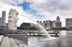 Singapore, Merlion Park, Marina Bay. Asia. The fountain in front of the Esplanade theaters in Bay Bay in Singapore. Merlion is an imaginary creature with the Royalty Free Stock Images